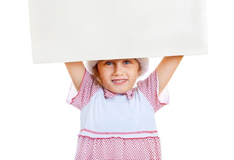 有空白的委员会的小女孩 库存图片