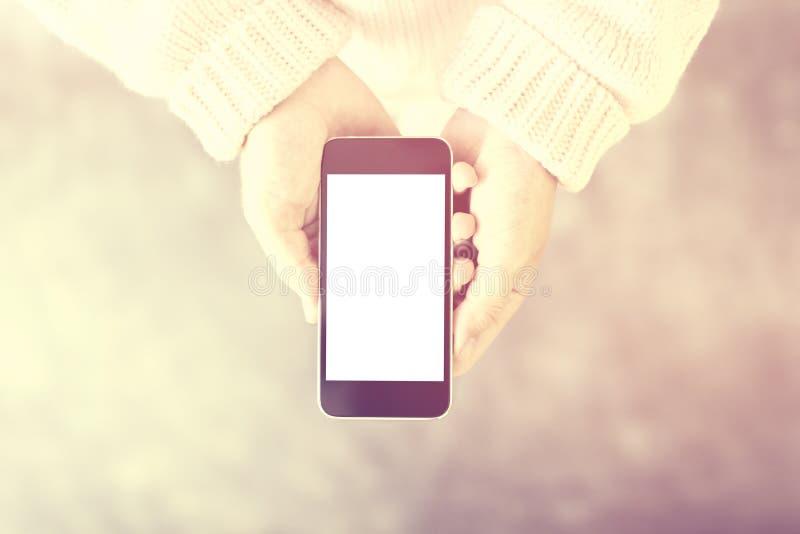 有空白的智能手机屏幕的, instagram照片作用,嘲笑女孩 免版税库存图片