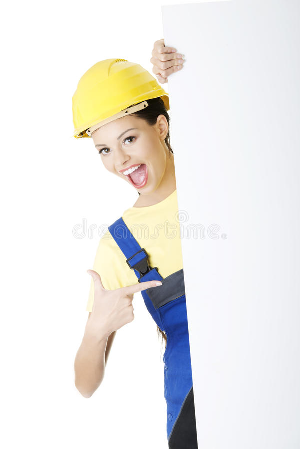 有空白董事会的女性建筑工人 库存图片