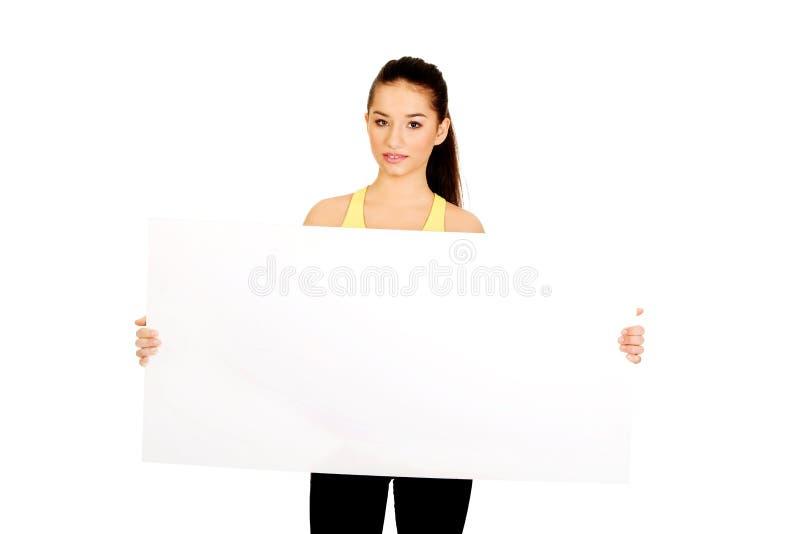 有空的招贴的健身妇女 库存照片