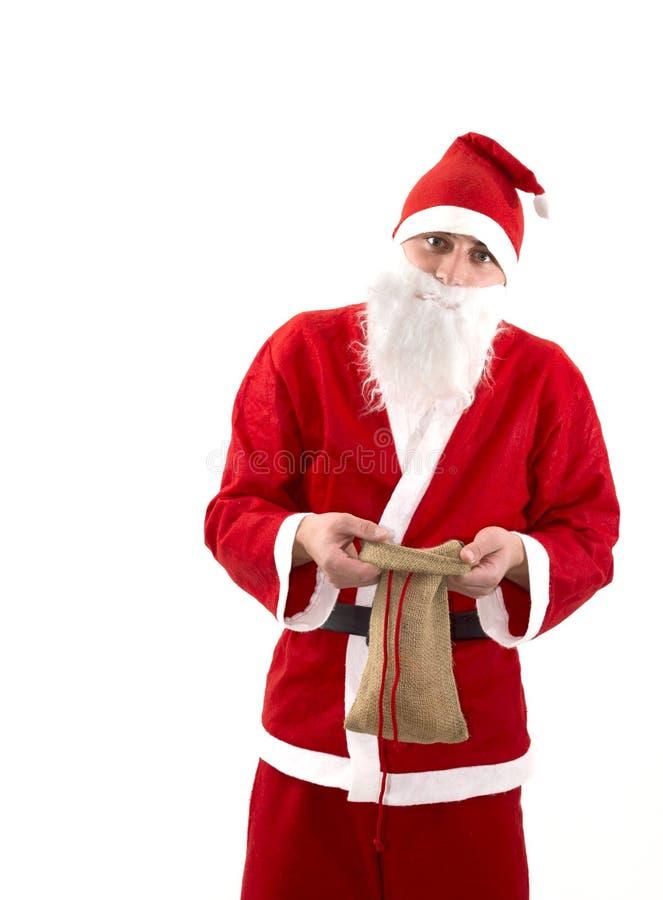 有空的袋子的可怜的圣诞老人在演播室 库存照片