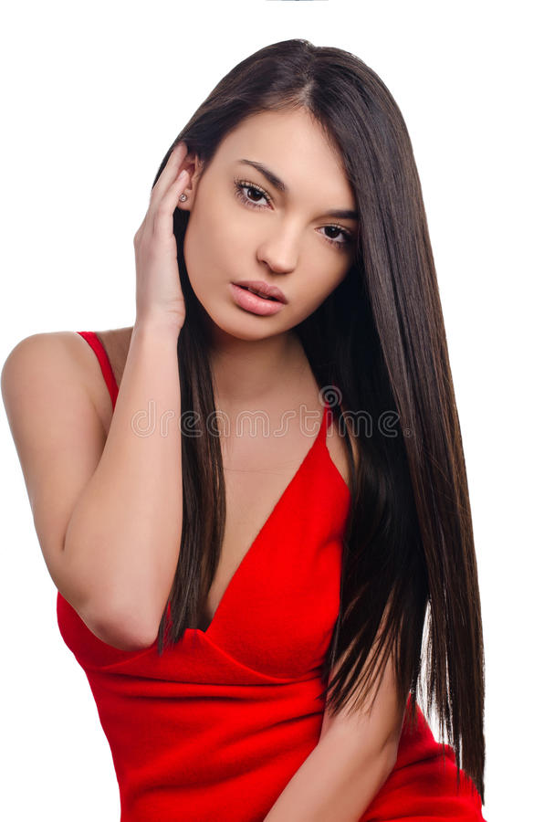 红色礼服的性感的女孩。 免版税库存图片