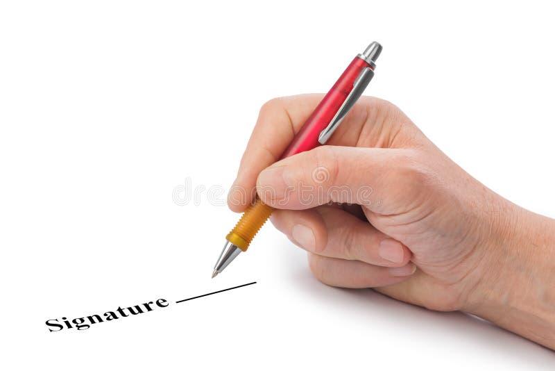 有笔和合同的手 免版税库存图片