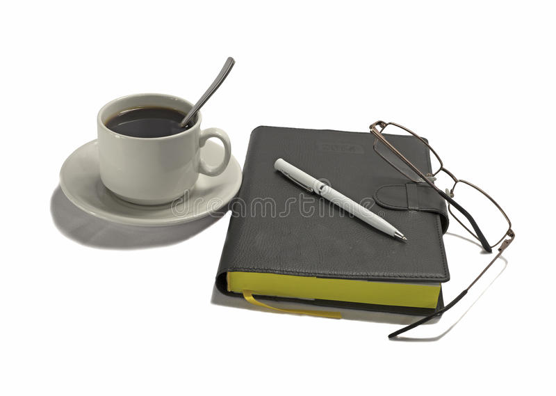 有笔和咖啡的笔记本 库存图片