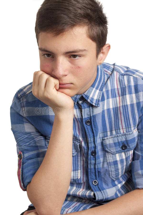 有粉刺问题的十几岁的男孩 免版税库存照片