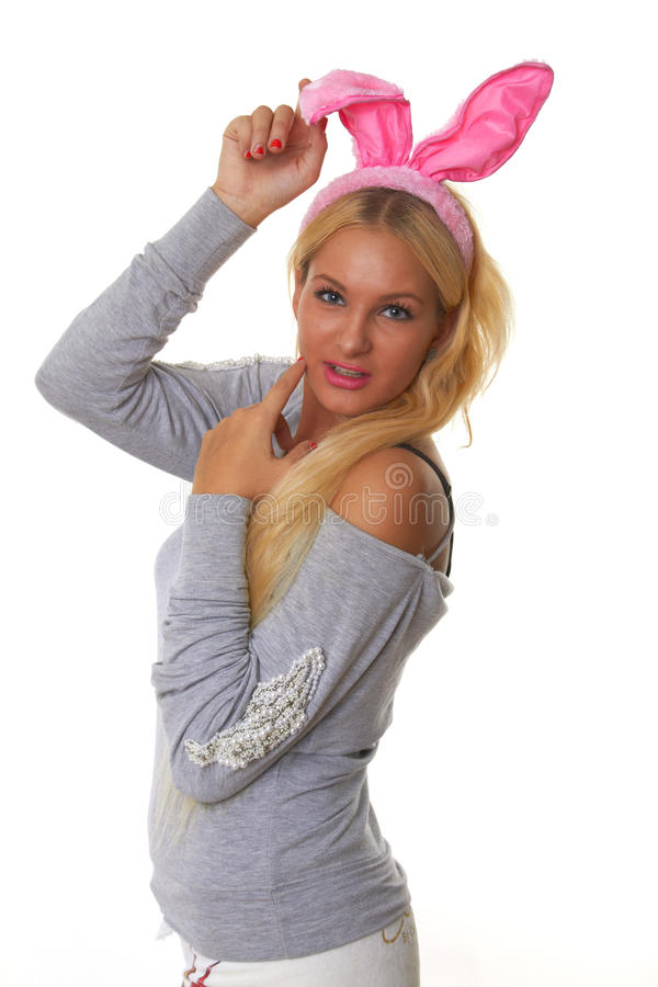 有粉红色室用V字型天线的美丽的女孩在他的题头 免版税库存照片