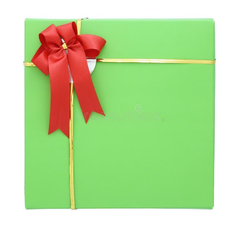 有红色丝带弓的绿色礼物盒 库存图片