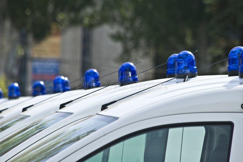 有红色和蓝色颜色警报器的警车 免版税库存照片