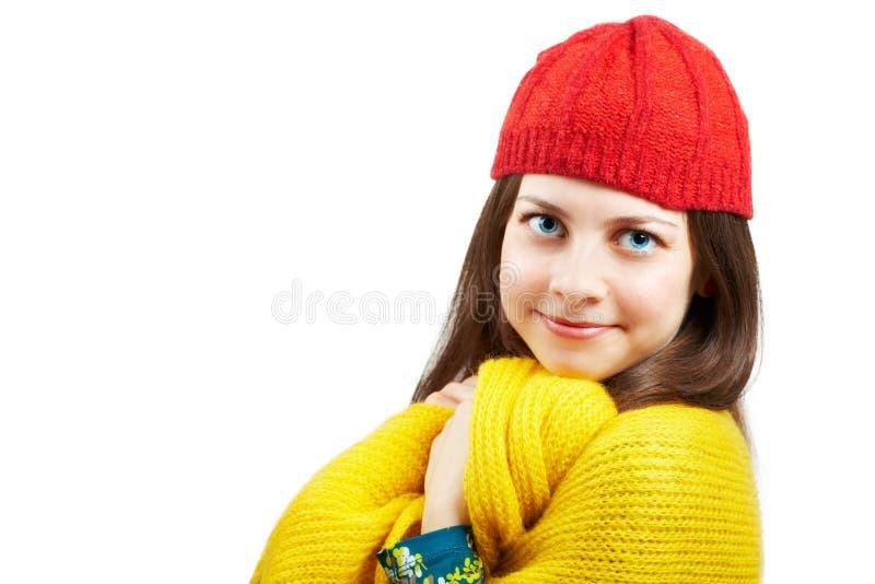 有红色帽子的俏丽的妇女 库存照片