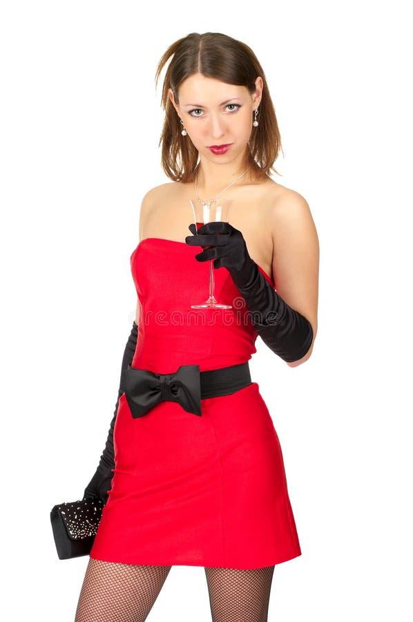 有红色玻璃的美丽的妇女  库存照片