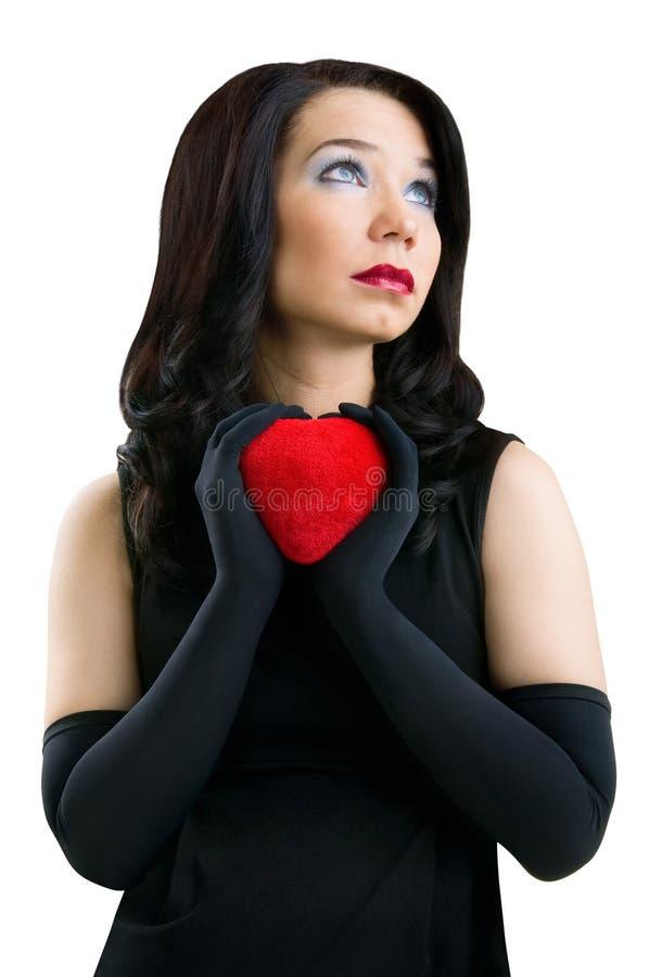 有红色重点的女性。 库存图片