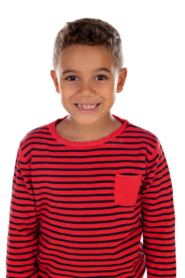有红色镶边衬衣的美丽的拉丁孩子 免版税库存图片