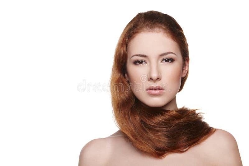 有红色头发的美丽的妇女 库存照片