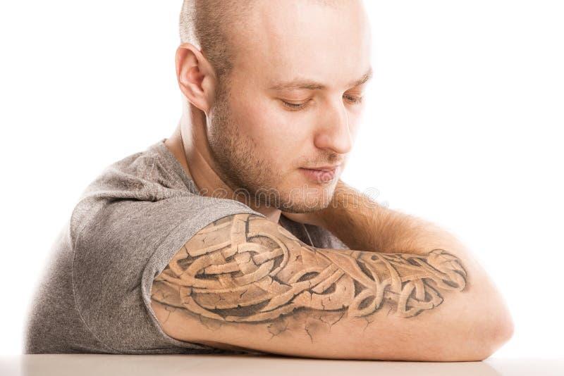 有纹身花刺的人 库存图片