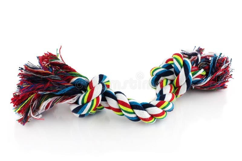 有结的耐咀嚼的五颜六色的狗绳索玩具 r 免版税库存图片