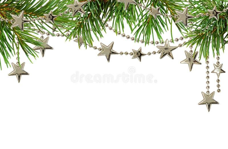 有绿色圣诞树的枝杈的银色诗歌选顶面borde的 免版税库存图片