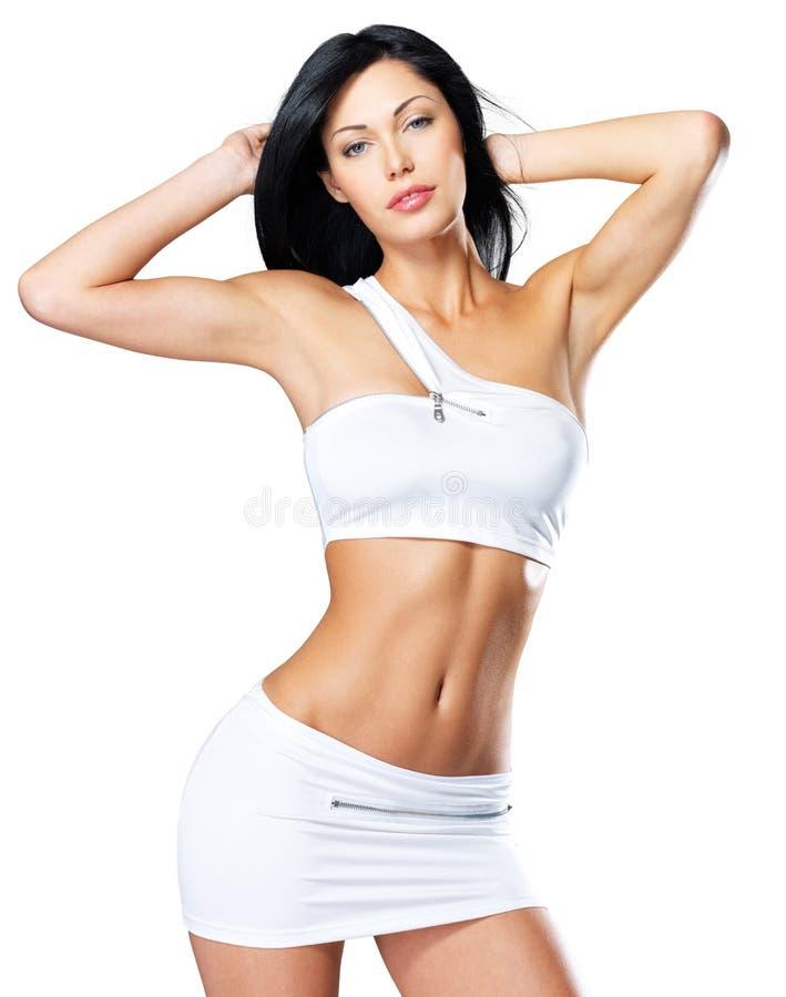 有美丽的妇女减肥被晒黑的身体 免版税图库摄影