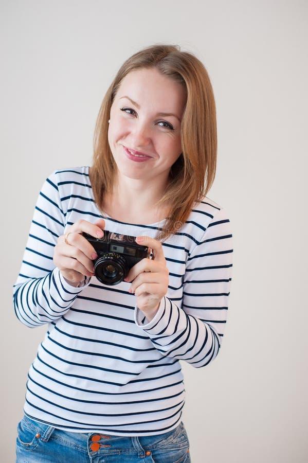有老照相机的女孩 库存照片