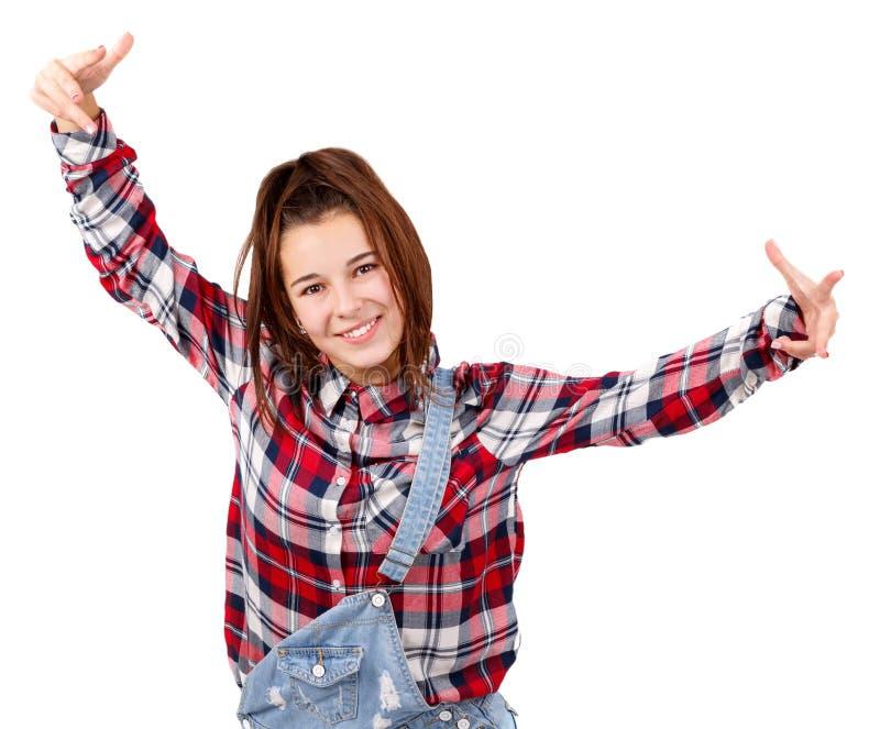 有耳机听的音乐音乐少年女孩跳舞的少妇反对被隔绝的白色背景 免版税库存图片