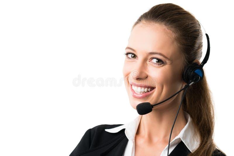 有耳机的可爱的女实业家 免版税图库摄影