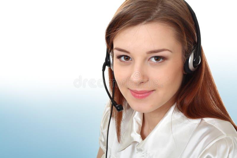 有耳机的女商人 免版税库存照片