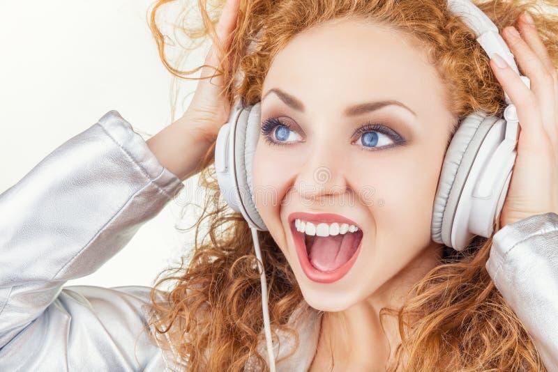 有耳机的女孩 库存图片