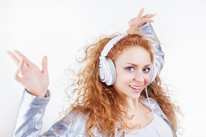 有耳机的妇女 库存图片