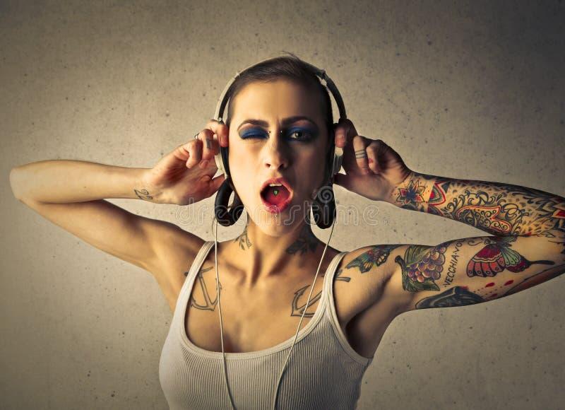 有耳机的妇女 图库摄影