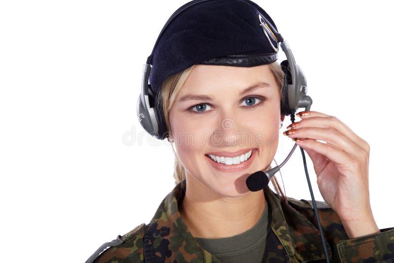 有耳机的战士妇女 库存图片