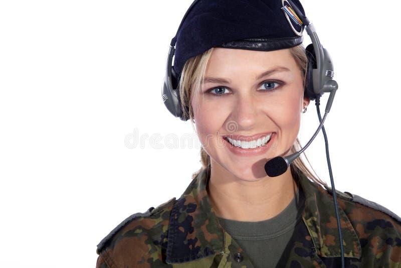 有耳机的战士妇女 免版税库存照片