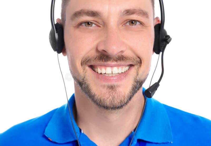 有耳机的技术支持操作员在白色背景 库存图片