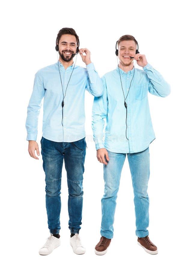 有耳机的技术支持操作员在白色 库存照片
