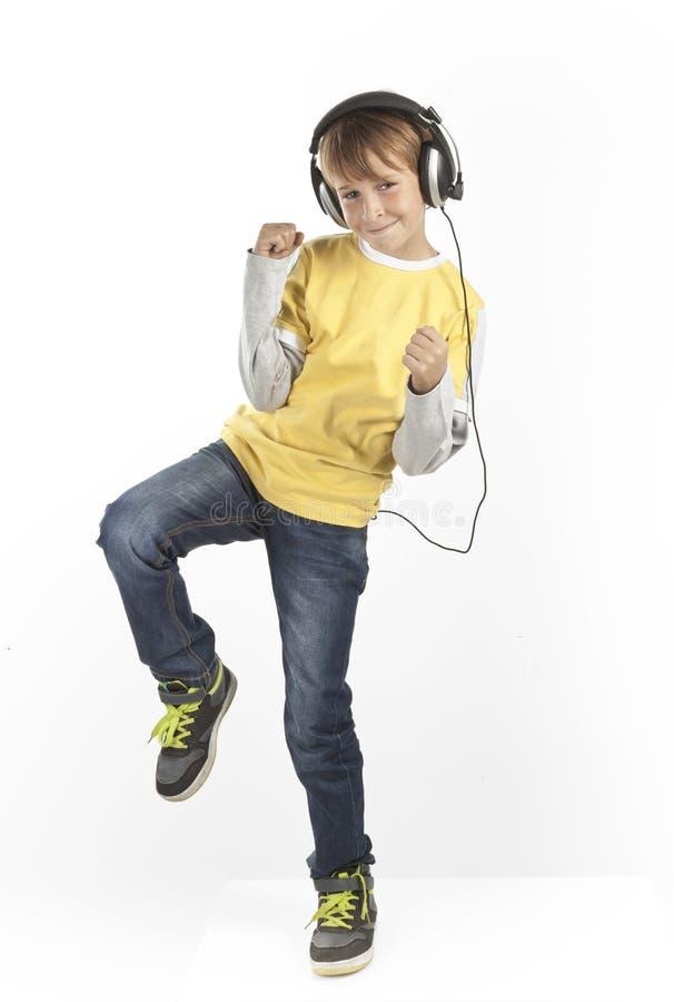 有耳机的男孩 库存图片
