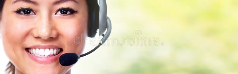 有耳机的秘书 库存照片
