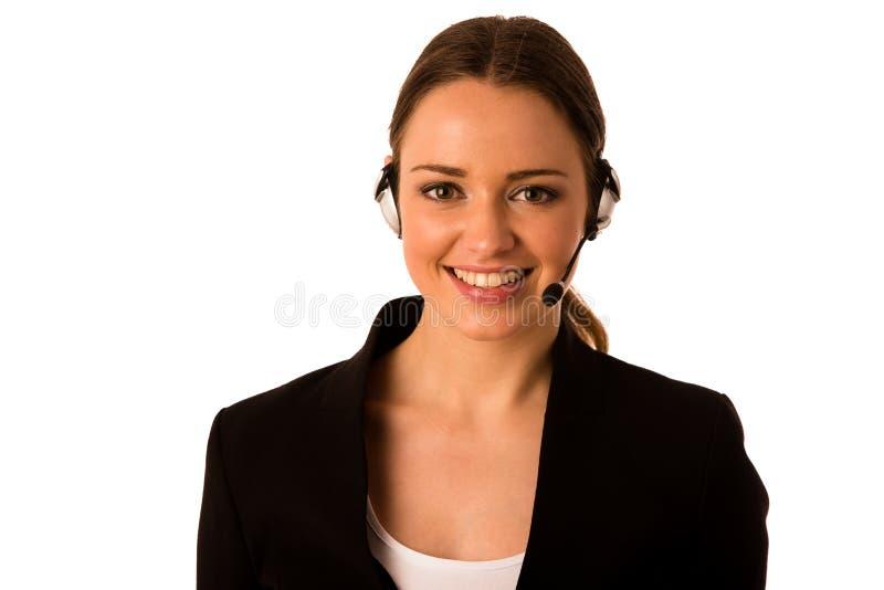 有耳机的Preety愉快的亚裔白种人女商人 库存照片