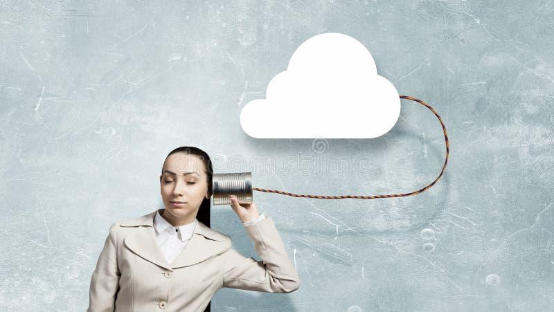 有聋电话的妇女 免版税库存照片