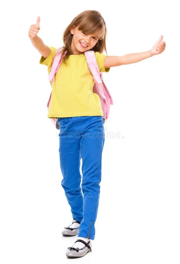 有背包的小女小学生 免版税库存图片