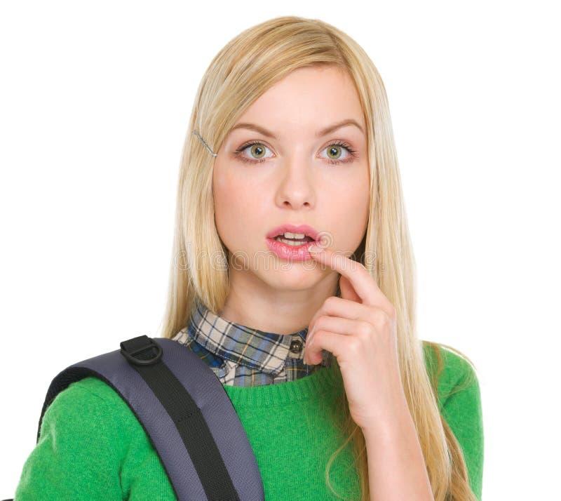 有背包的惊奇的学员女孩 免版税库存照片