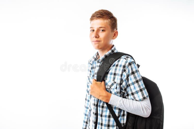 有背包的男孩男小学生,上学,学生画象,白色背景的演播室 免版税库存照片