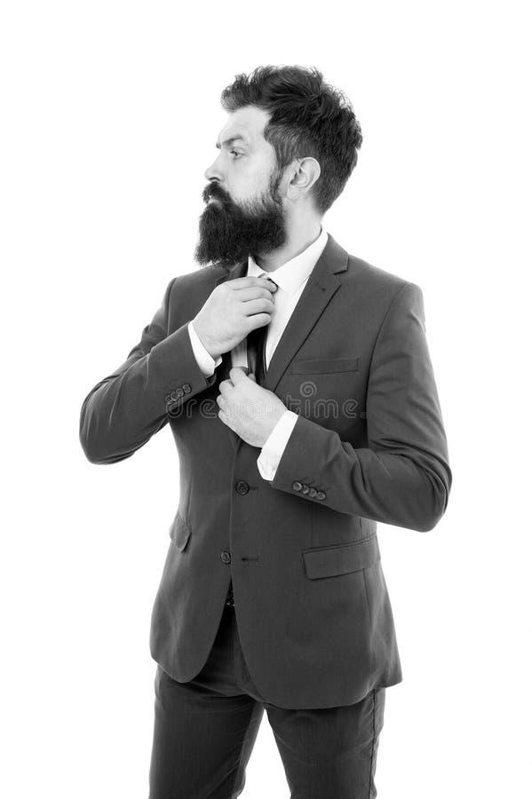 有胡子的人确信的姿势隔绝了白色 有胡子正装办公室工作者的行家 商人正装 免版税库存图片