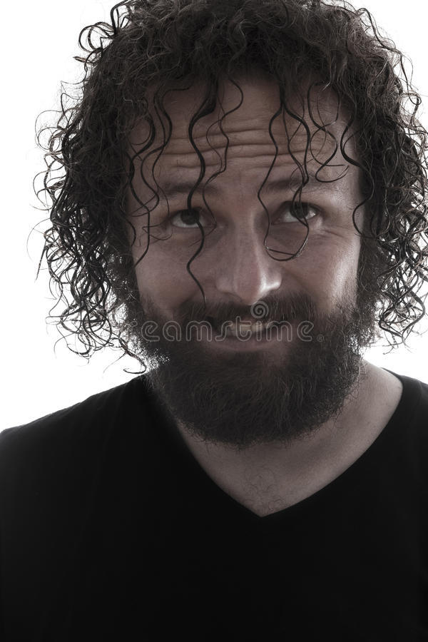 有胡子的疯狂的人微笑的画象 免版税图库摄影