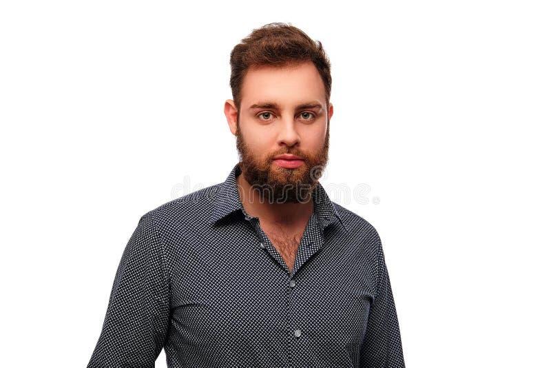 有胡子,微笑的男性画象与横渡的胳膊的 免版税库存图片