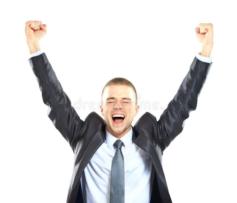 有胳膊的激动的英俊的商人在成功上升了 免版税库存图片