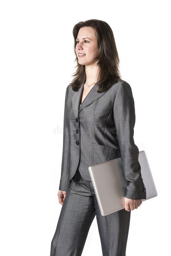 有膝上型计算机的女商人 免版税库存图片