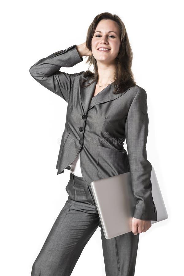 有膝上型计算机的女商人 库存图片