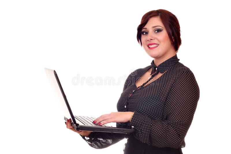有膝上型计算机的女孩在白色 库存照片