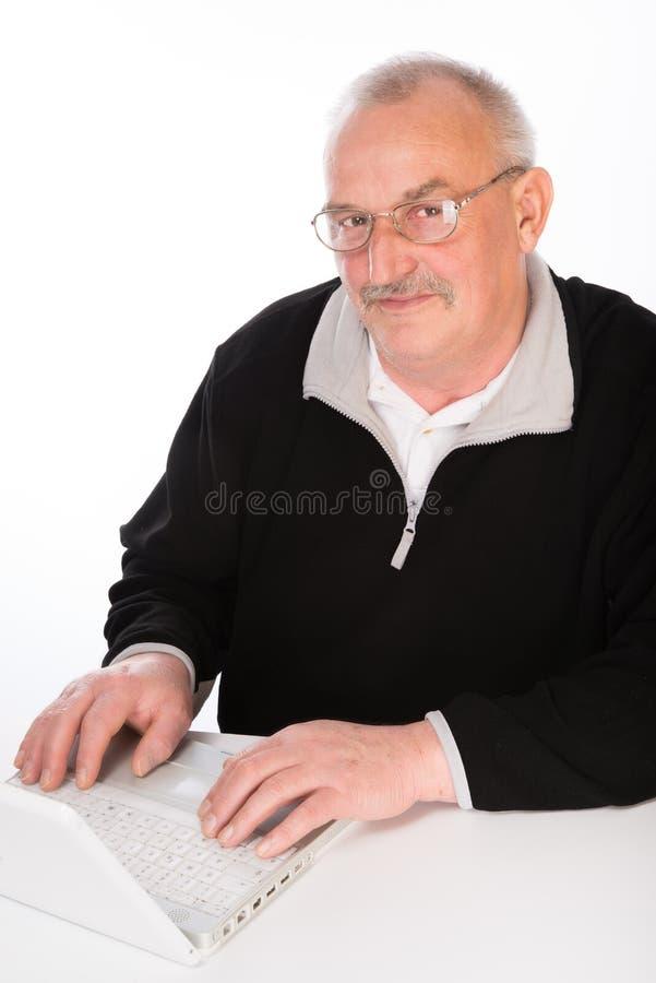 有膝上型计算机的成熟人 图库摄影