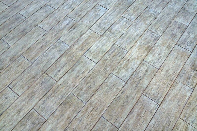 有自然灰的木织地不很细Patte陶瓷镶花地板瓦片 图库摄影