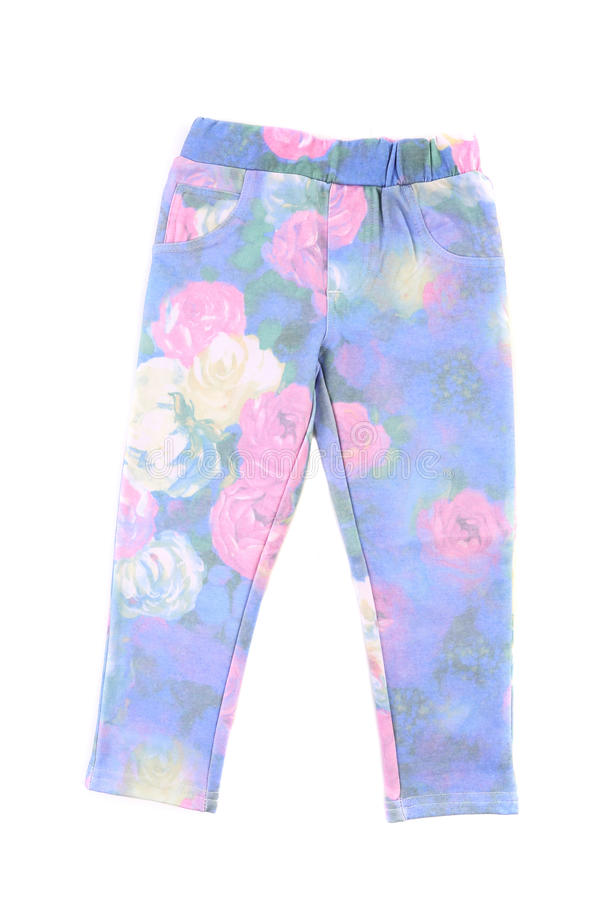 有花卉图案的孩子裤子。 免版税库存图片