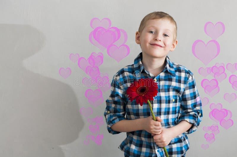 有花的一个男孩 图库摄影